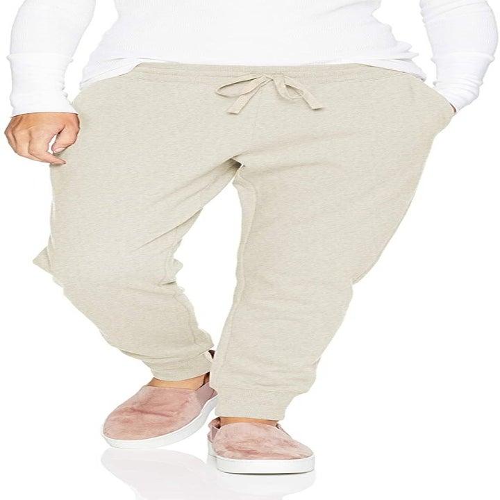Model wearing cream joggers