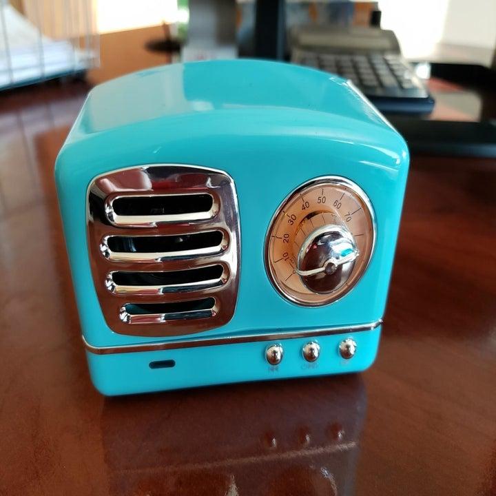 Mini blue retro Bluetooth speaker placed on desk