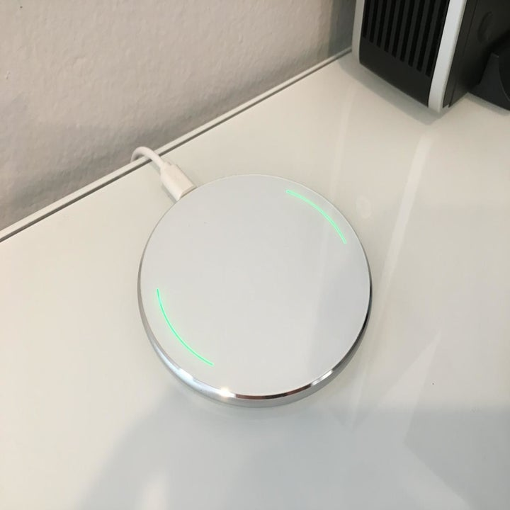 White wireless charger placed on desk
