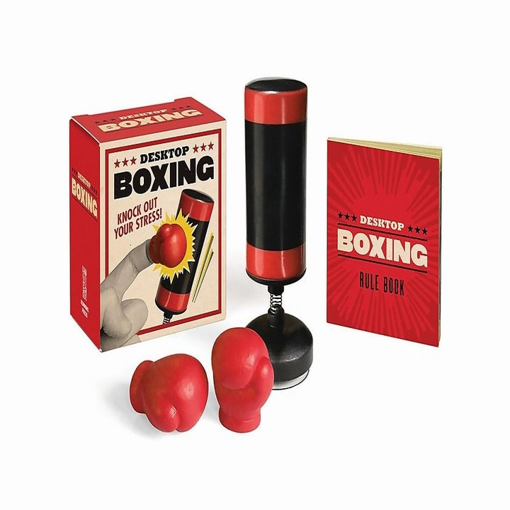 Products shot of mini punching bag with two tiny finger gloves, a mini booklet and product box