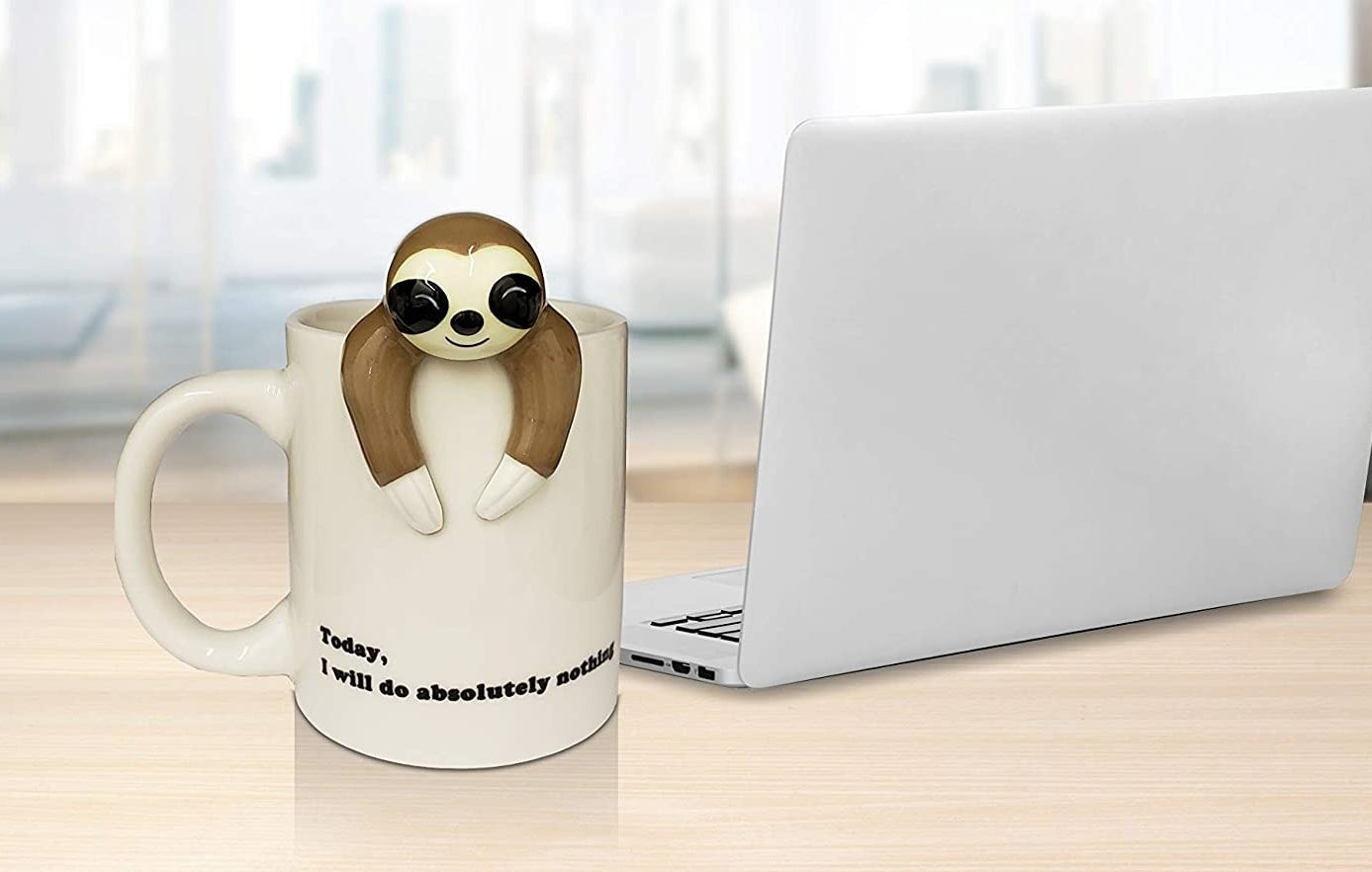 Coffee mug with sloth-shaped figure attached on the edge