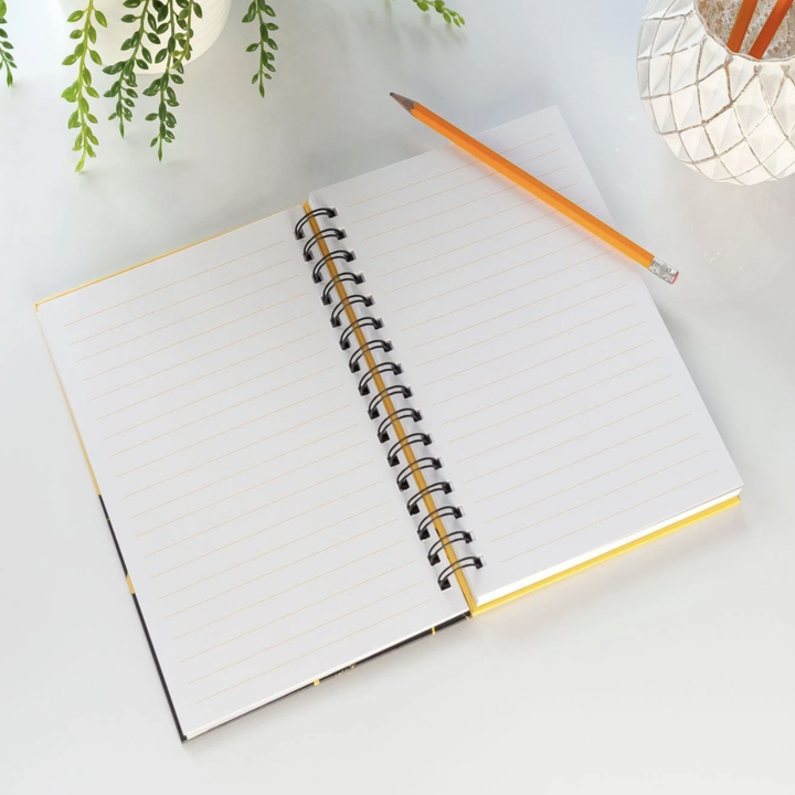 Notebook open to reveal lined paper