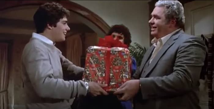 The father in Gremlins gives his son, Billy, a wrapped Christmas gift