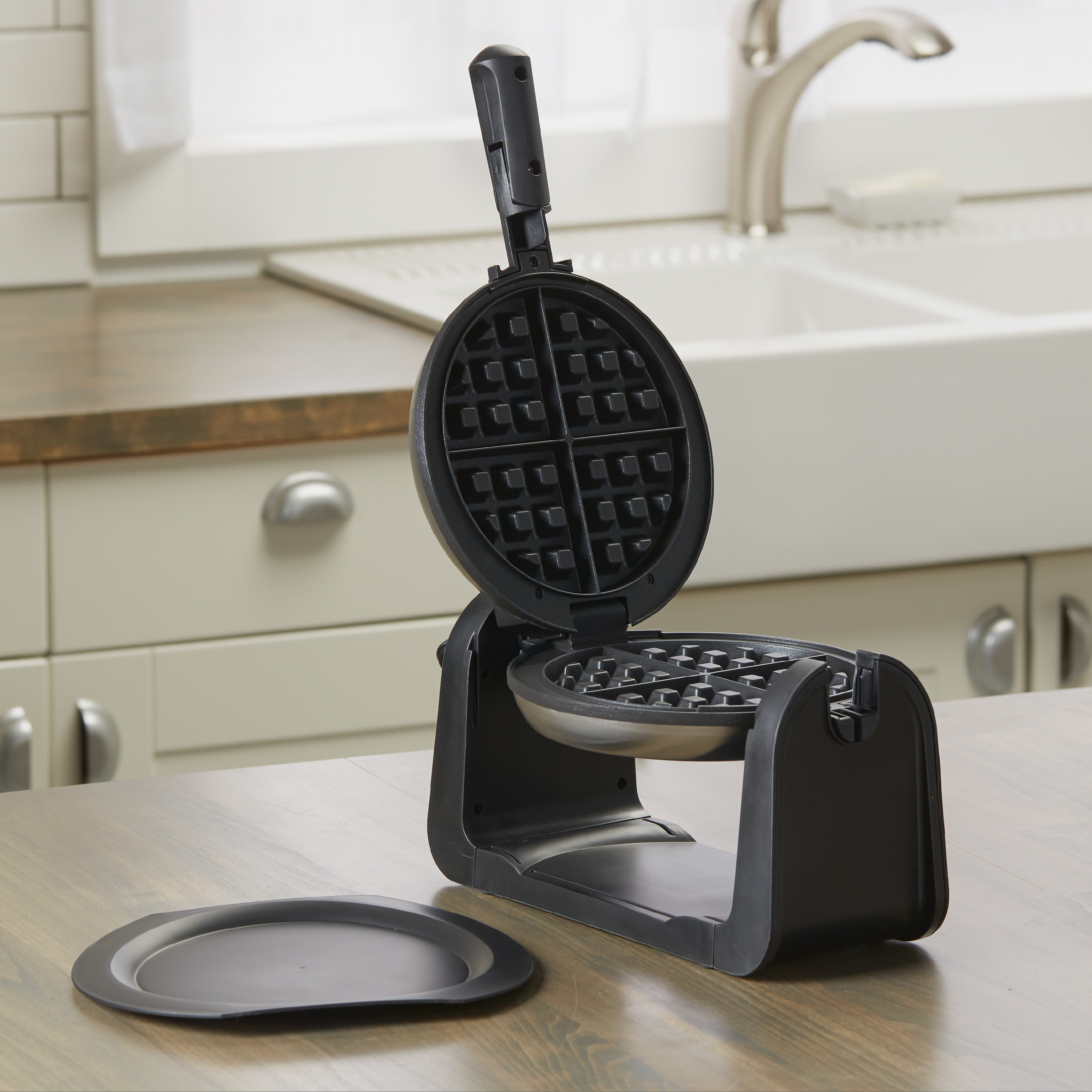 the waffle maker open in the kitchen