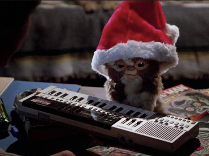 Gizmo the Gremlin wearing a Santa hat
