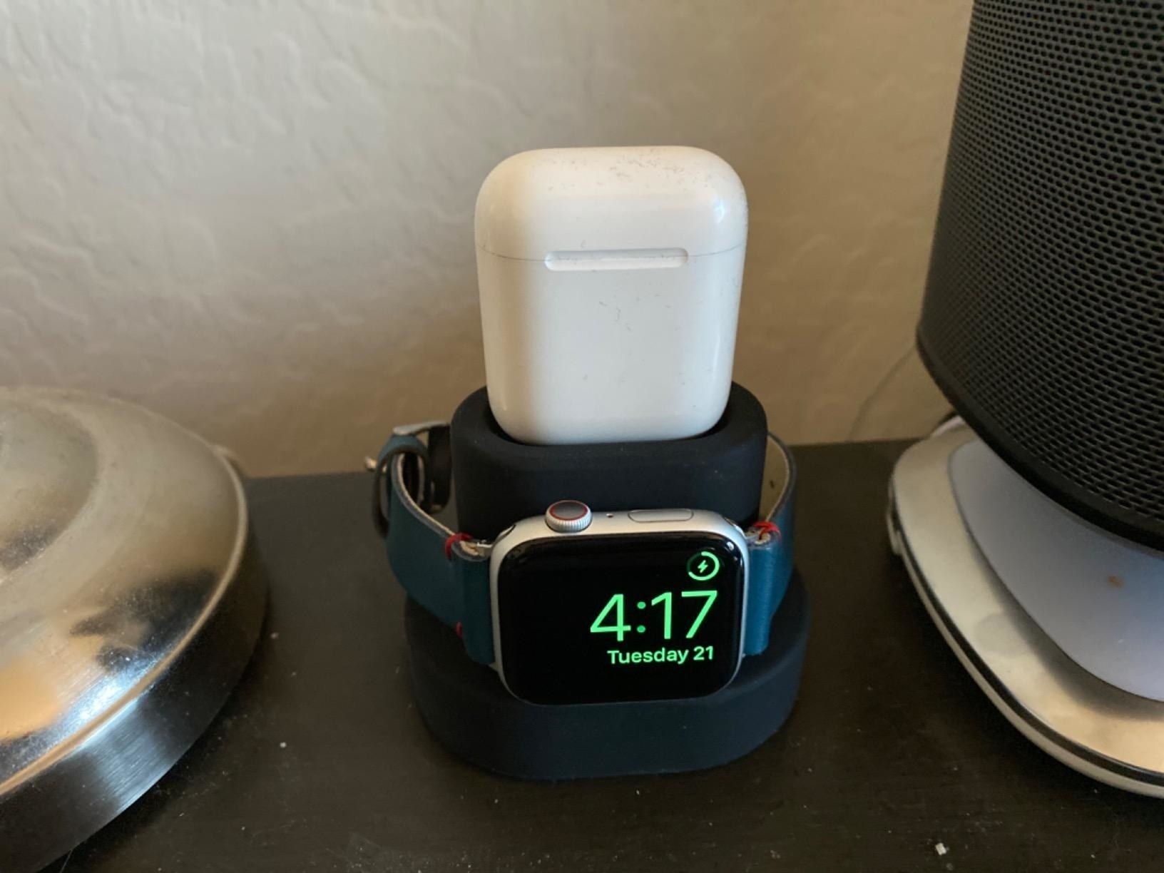 Reviewer's AirPods case and Apple Watch charging simultaneously