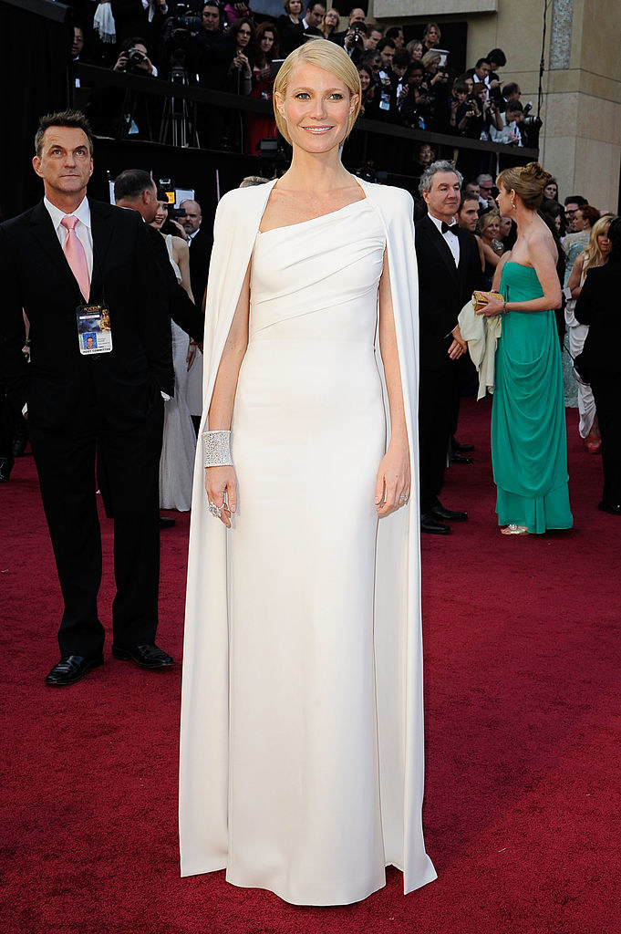 wearing a white gown cape