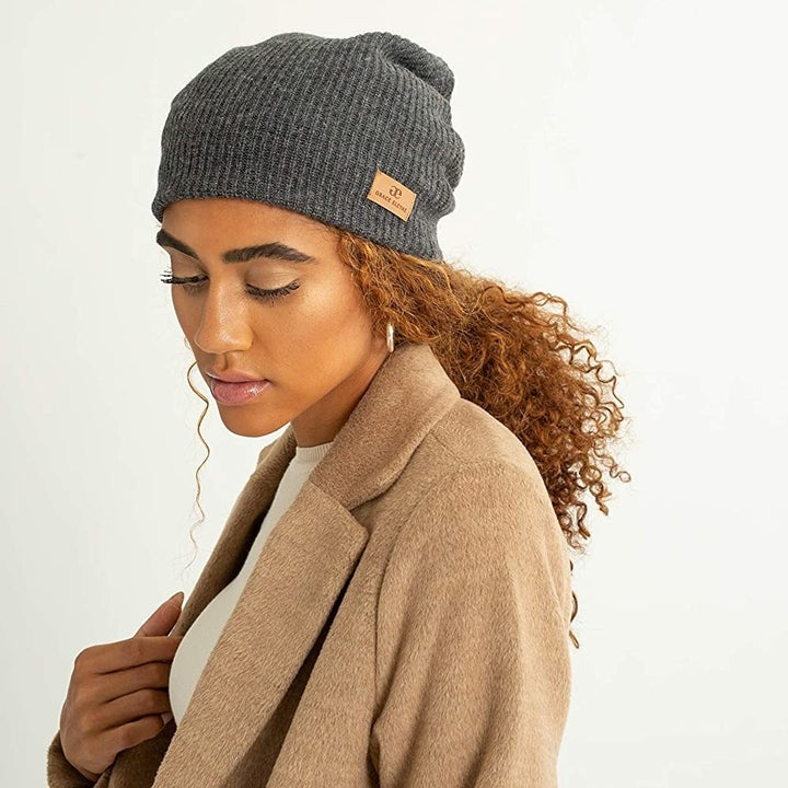 A model wearing the gray beanie
