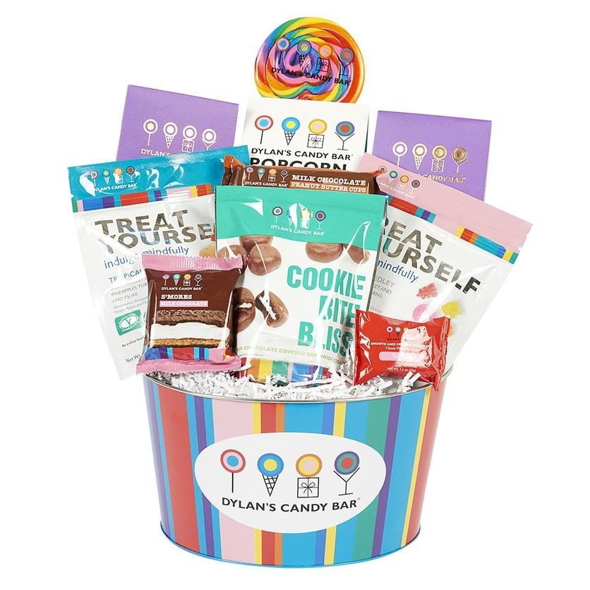 rainbow striped bucket filled with various types of candy