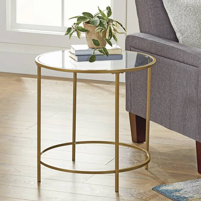 Round gold-finished side table