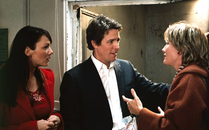 "Martine McCutcheon, Hugh Grant, and Emma Thompson in a scene from ""Love Actually"""