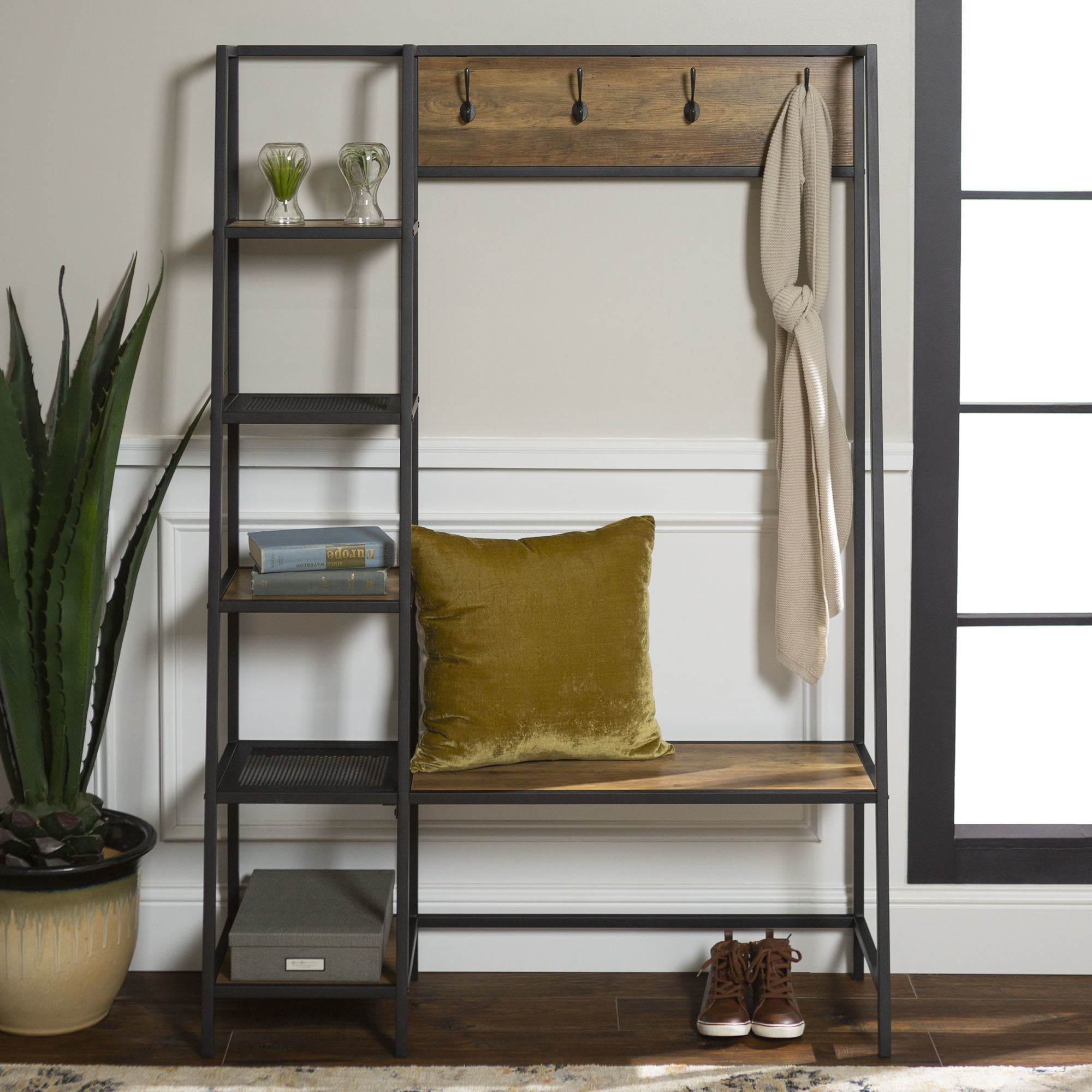 The black and brown hall tree with five side shelves, a coat rack, and small bench