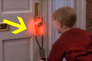 Kevin from Home Alone hanging a hot ring on the front door handle