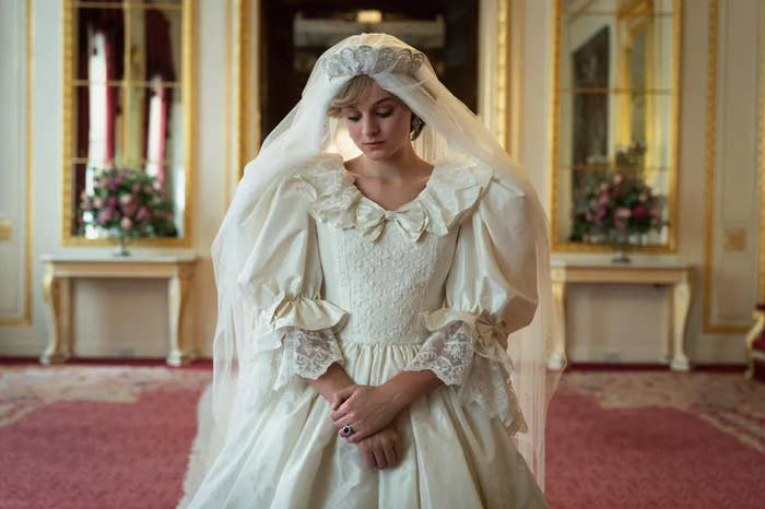 Emma Corrin as Princess Diana; she is wearing a recreation of Diana's wedding dress