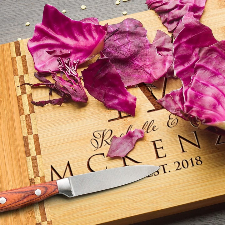 Cutting board with couple's name and wedding date laser printed on front