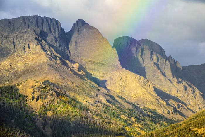 Rainbow over jagged grey mountains