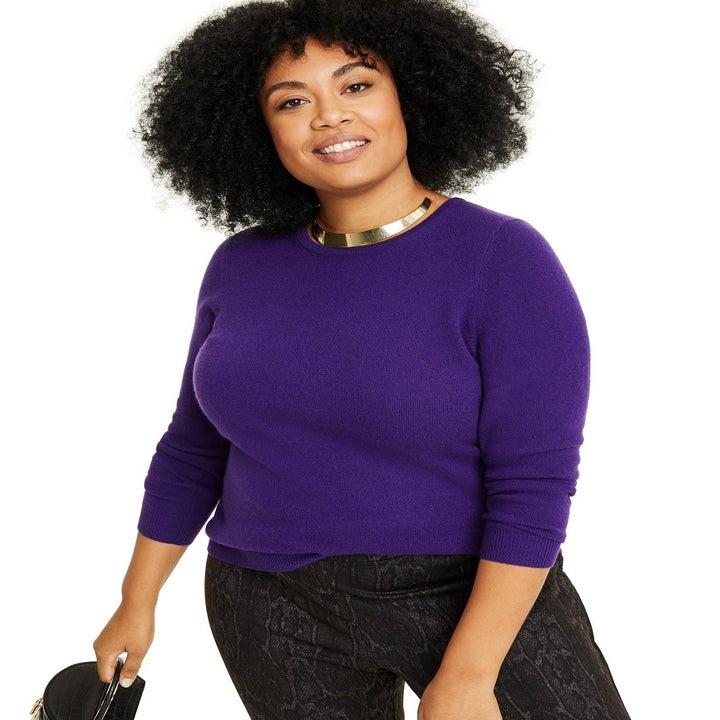 A different model wearing the sweater in purple noir
