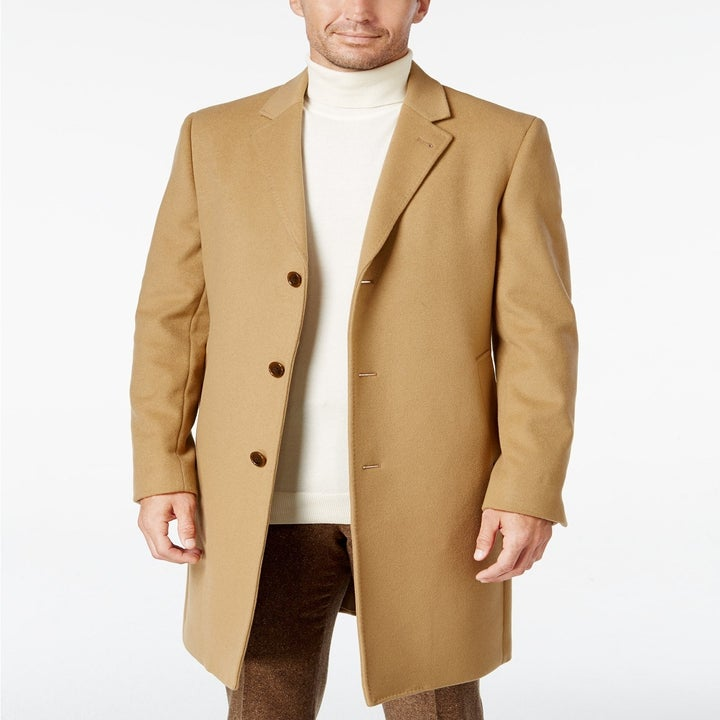 The same model wearing the coat in camel
