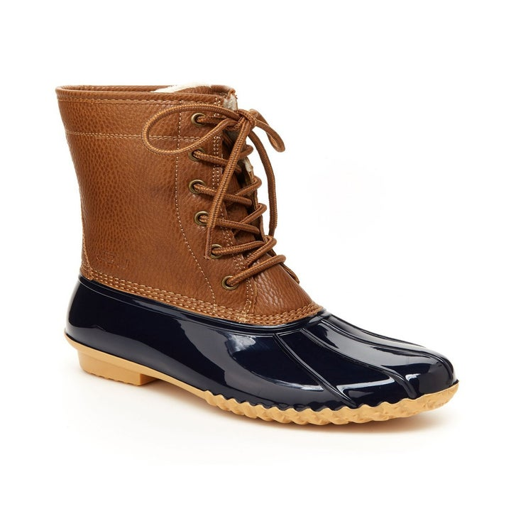 Side view of the lace-up boots in brown and navy