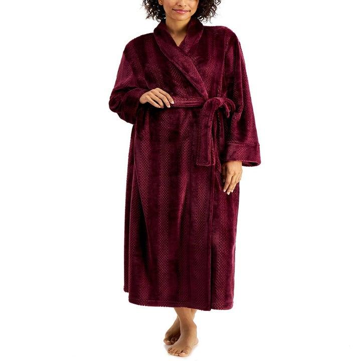 A model wearing the robe in wine