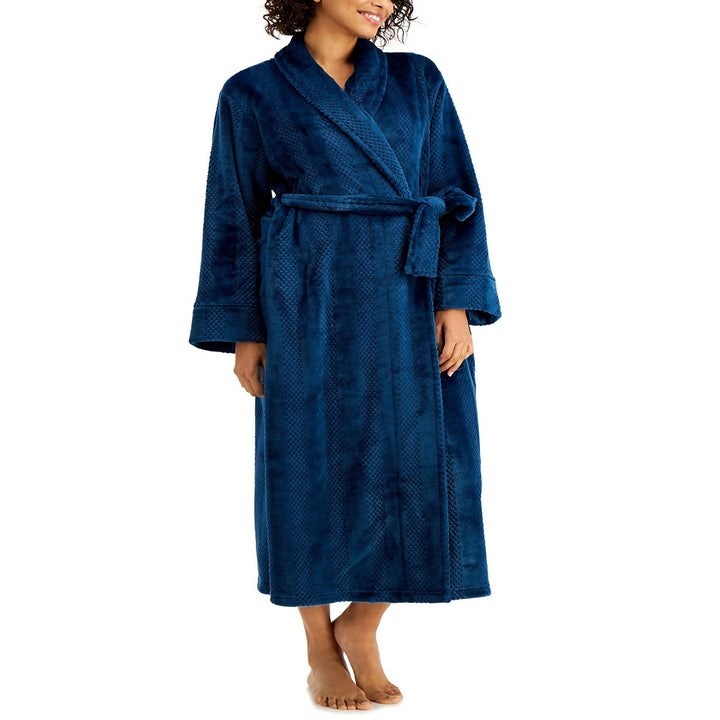 The same model wearing the robe in evening tide