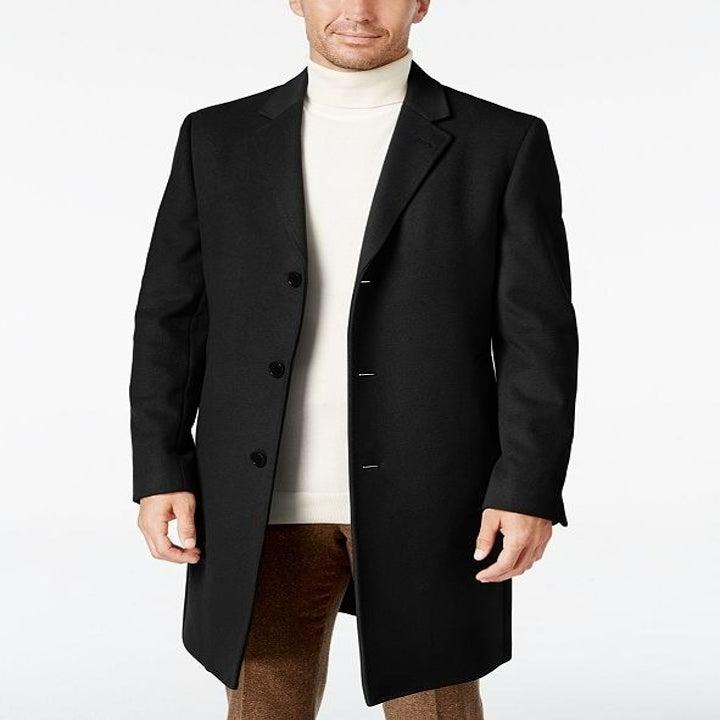 A model wearing the coat in black