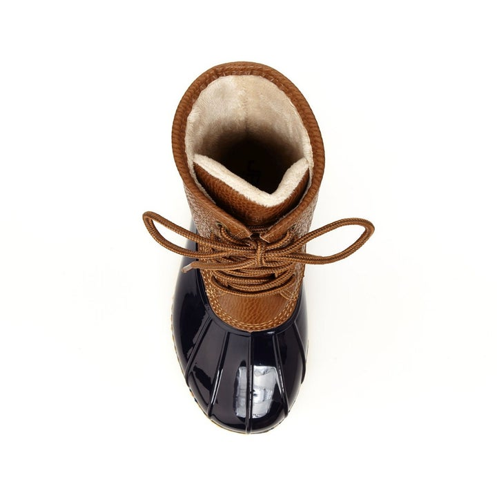 Top view of the brown and navy boot which shows its faux-fur lining