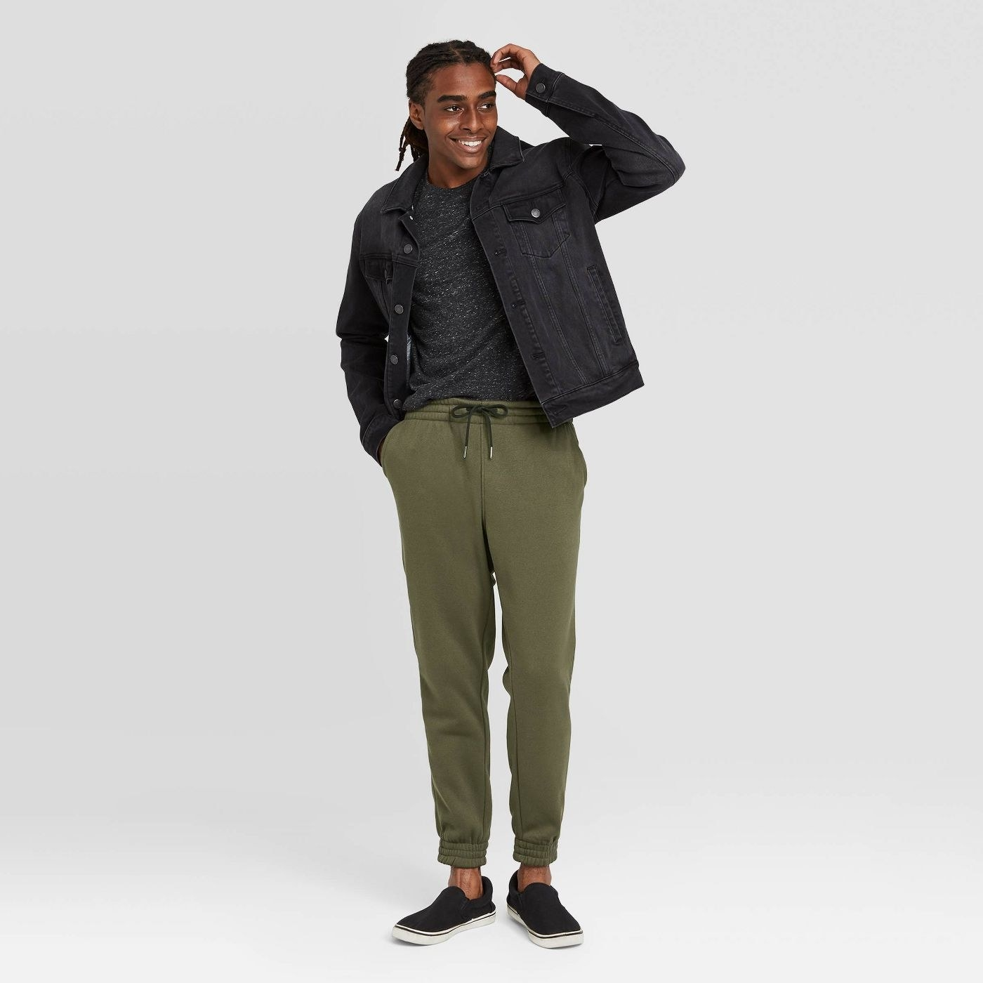 Model wearing the joggers in green