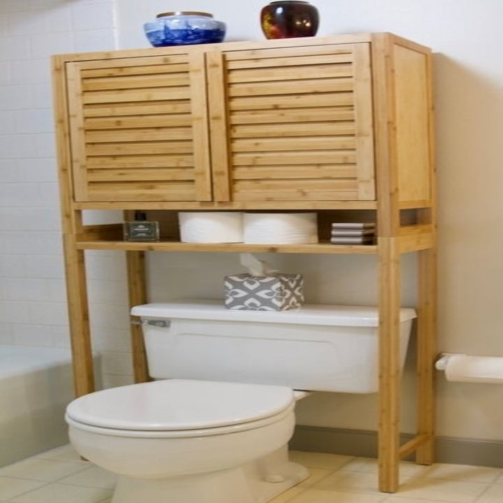the bay isle home mel bamboo over the toilet storage in a bathroom
