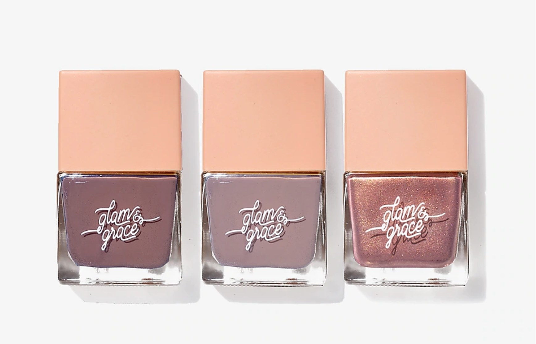A pack of three bottles of nail polish in mauve, pink, and shiny pink