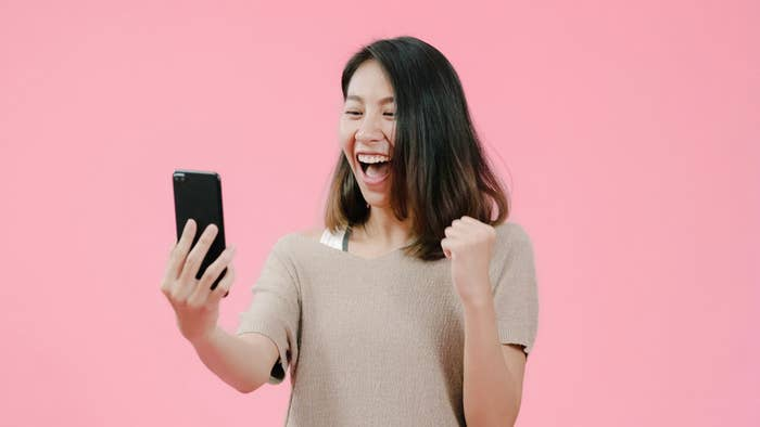 This person laughs while reading their phone
