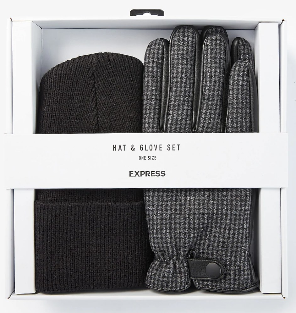 A packaged box with a black winter cap and black and gray gloves in it