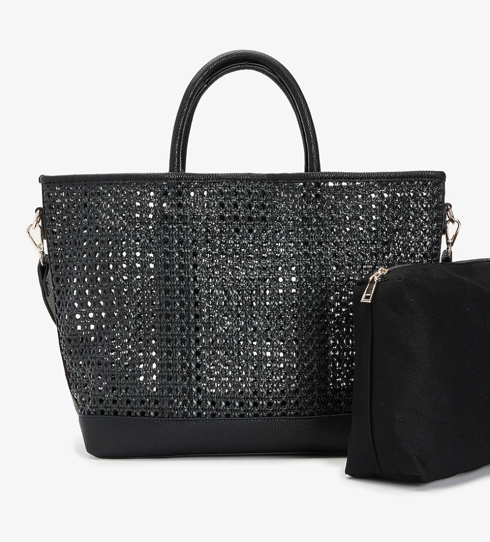 A big black tote with a smaller black cosmetic bag next to it