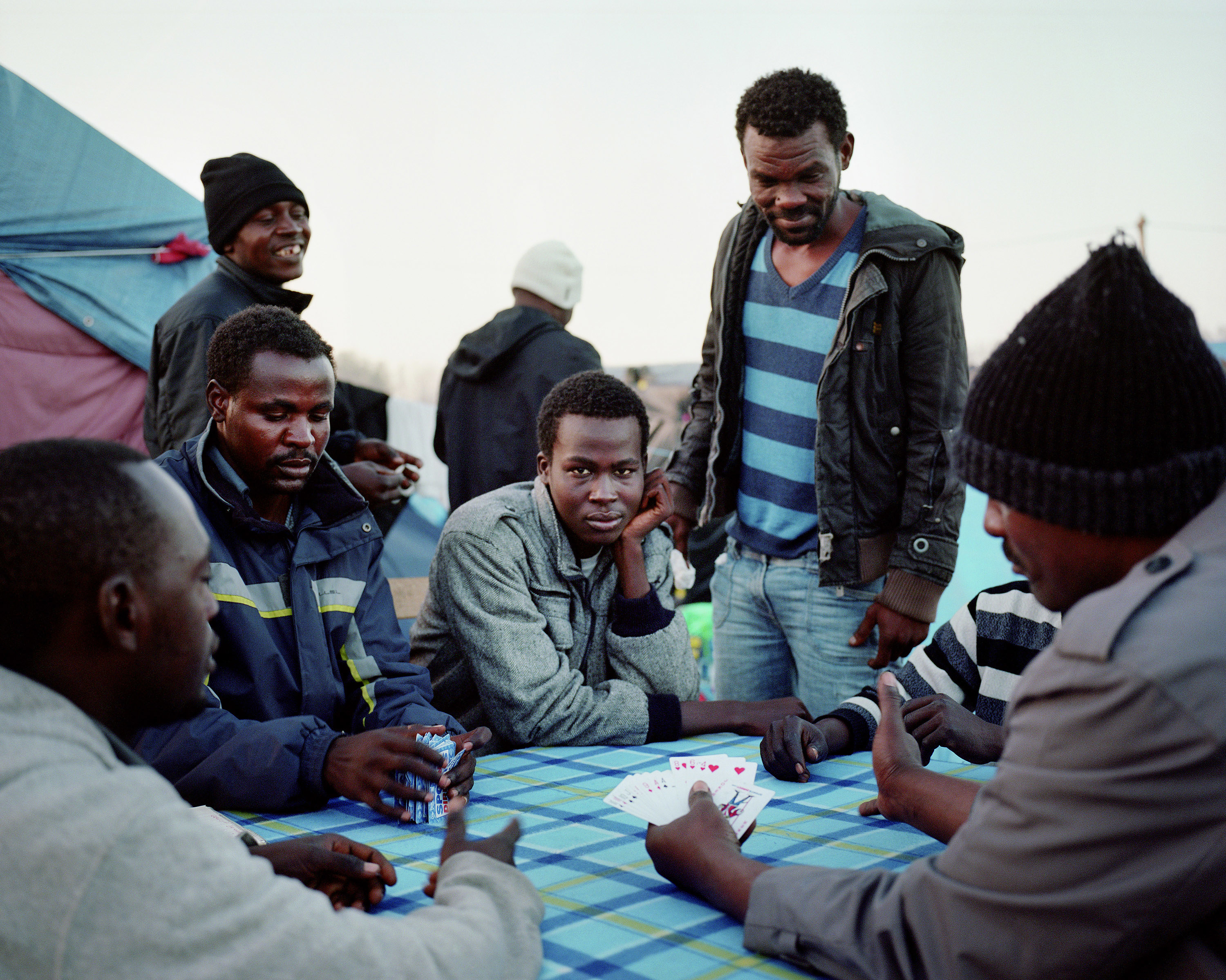 Men playing cards outside