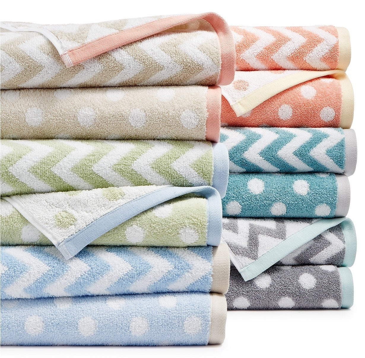 A stack of the tan, blue, green, grey, and coral towels
