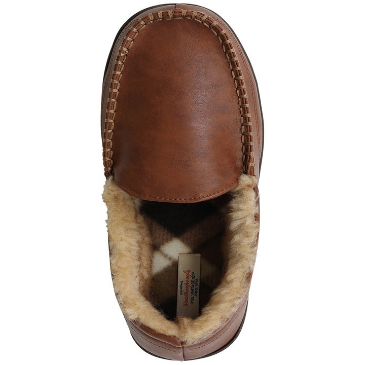 Top view of the tan faux-leather moccasins which have a faux-fur interior