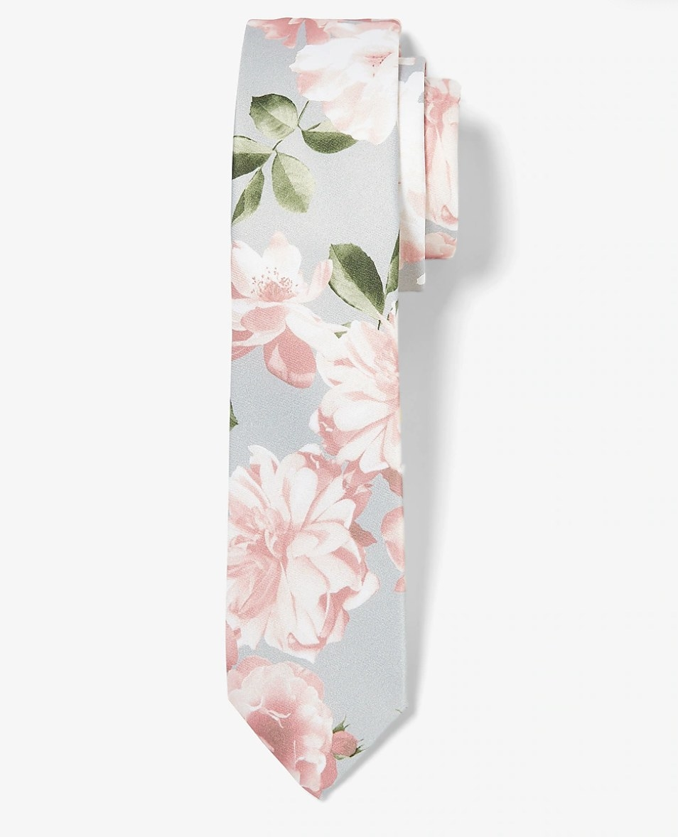 A gray tie with pink flowers on it