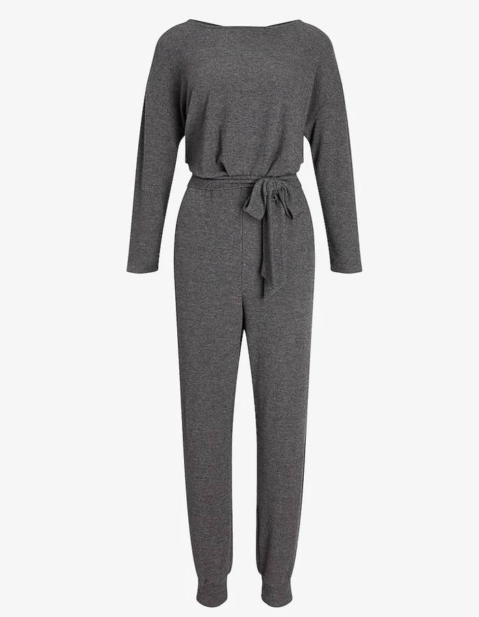 A dark gray jumpsuit with a belt