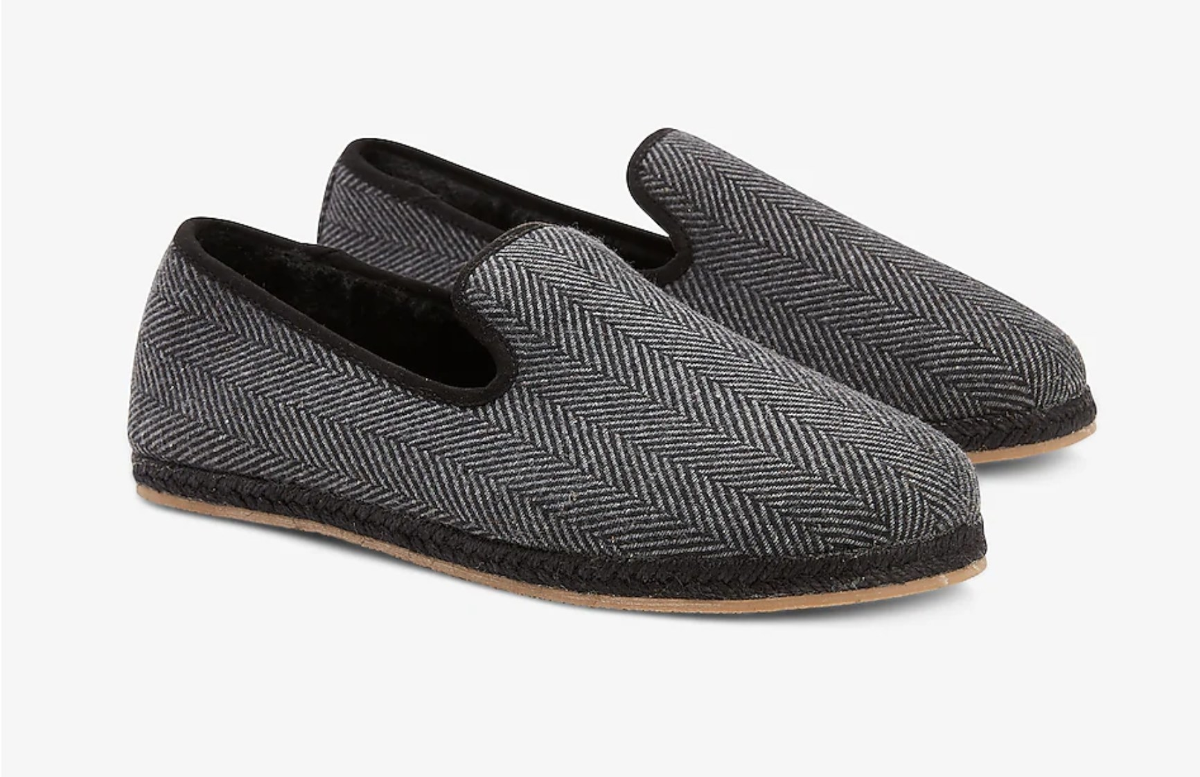 A pair of black and gray house slippers