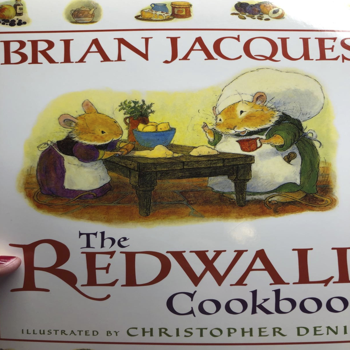 cookbook with the two mice standing at the table