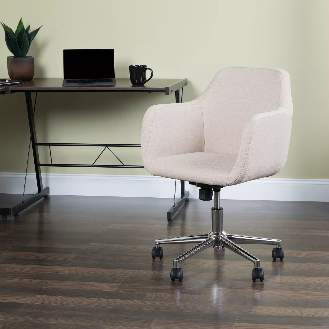 White upholstered desk chair on wheels