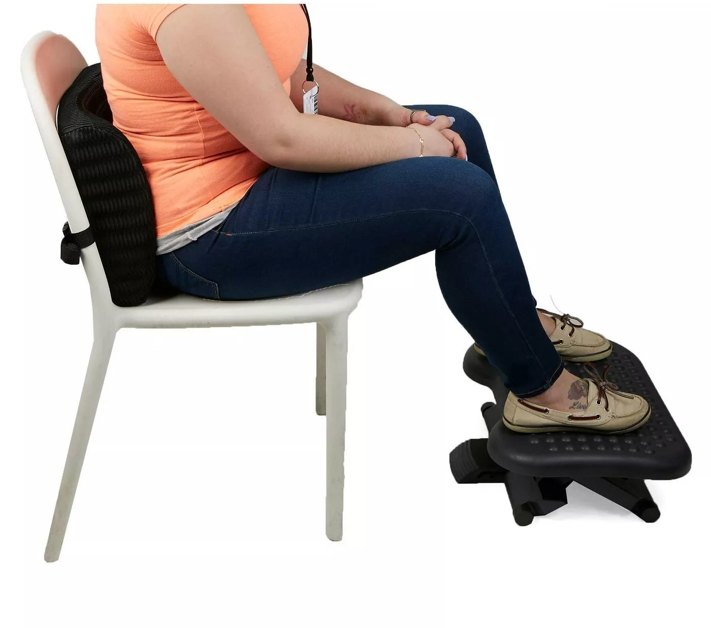 White chair with memory foam back support and adjustable foot rest