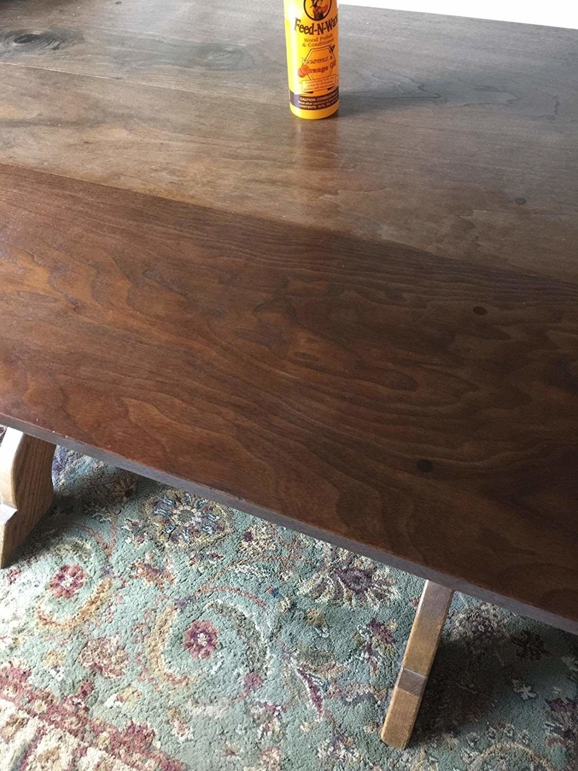 A before and after showing a wood table looks good as new after using the polish