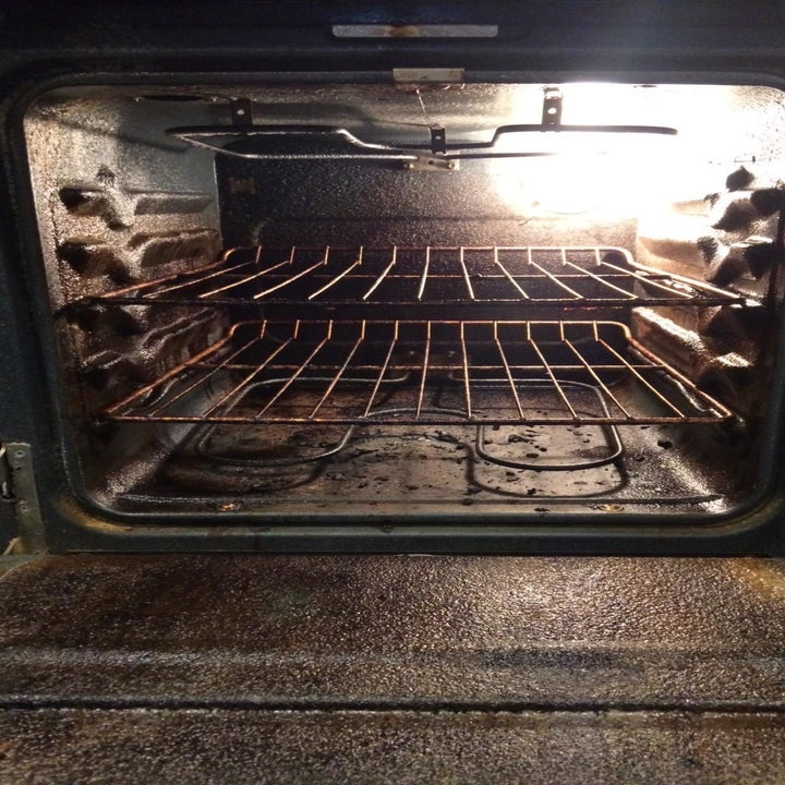 Reviewer photo of their dirty oven interior with lots of baked-on food bits
