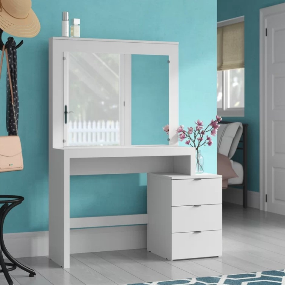 White vanity with large mirror and built in 3-drawer dresser