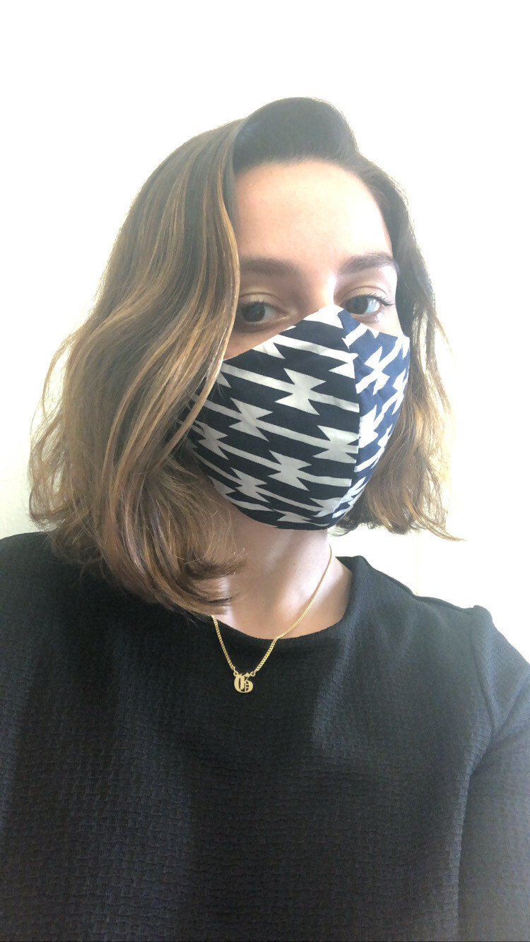 BuzzFeed editor in a black and white patterned face mask