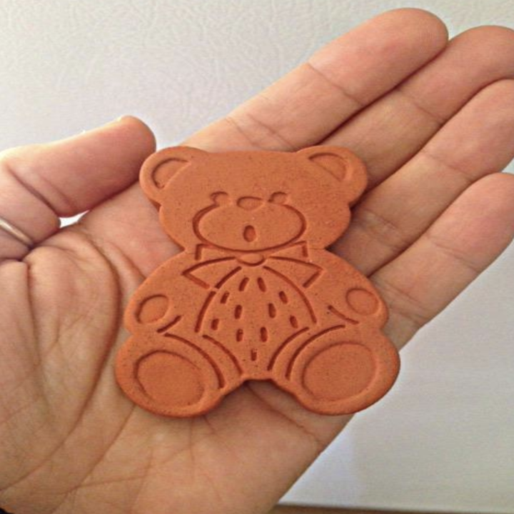 person holding sugar-saving bear
