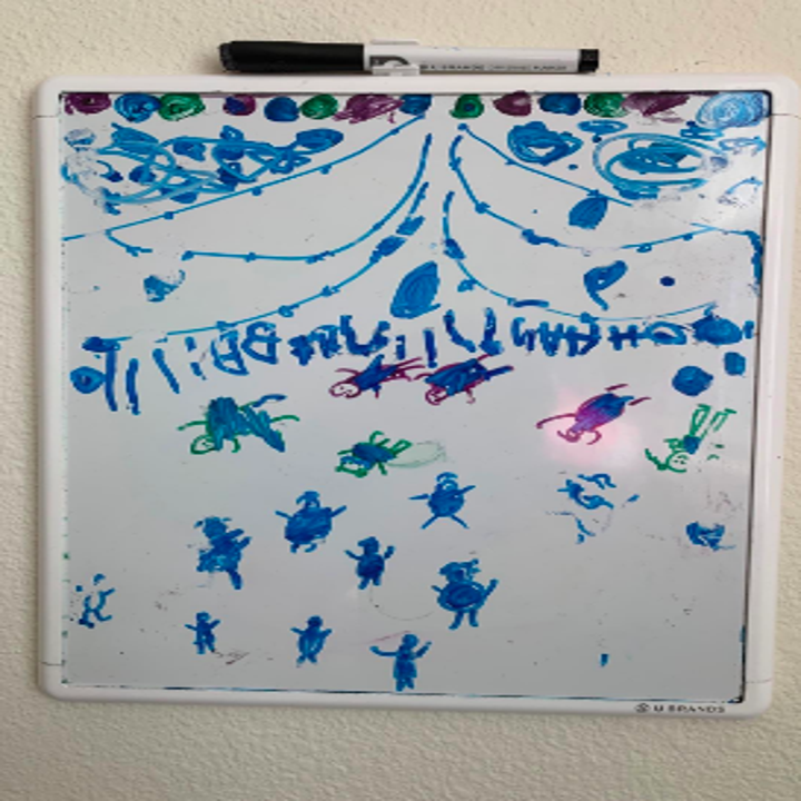 Reviewer image of child's drawings on whiteboard