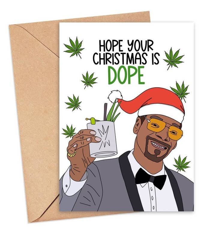"""A card with Snoop Dogg wearing a Santa hat and saying """"Hope your Christmas is dope"""""""