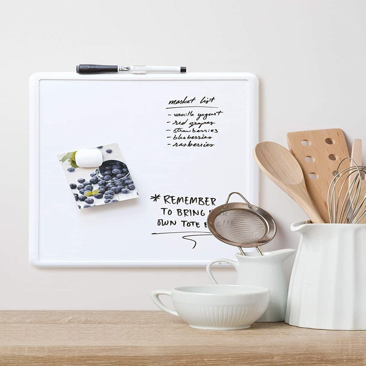 Lifestyle shot of board being used for grocery list